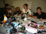 Soldering Party in the Cyber Studio Featuring &quot;the Boss,&quot; Maya, and Paul